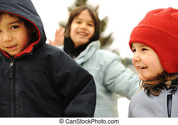 Happy group of children outdoor, winter clothes