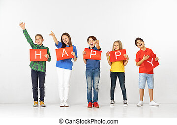 Happy. Group of children with red banners isolated in white