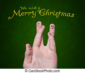 Happy group of finger smileys with merry christmas sign