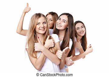 Happy group of friends gesturing thumbs up