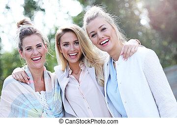 Happy group of friends outside in autumn season
