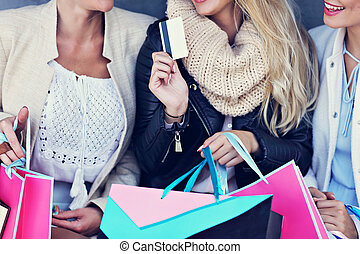 Happy group of friends shopping in autumn season - Happy...