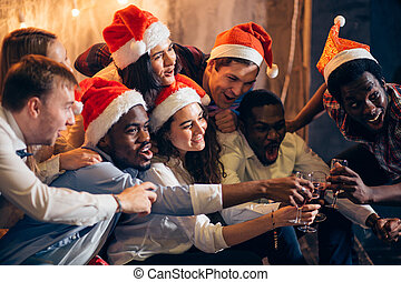 Happy group of friends touching the glases with each other -...