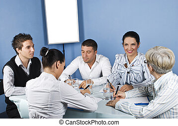 Happy group of people having conversation - Happy group of...