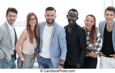 Happy group of people standing in a row over white background