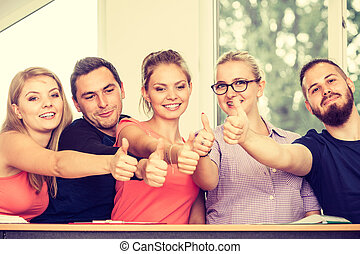 Happy group of students with thumbs up