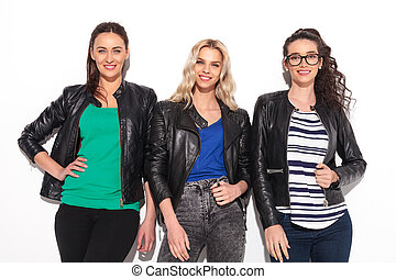 happy group of three women posing in studio
