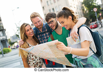 Happy group of tourists traveling and sightseeing - Happy...