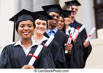 group of university graduates at graduation
