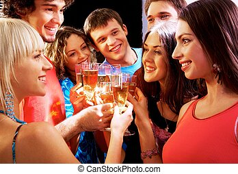 Happy group of young friends touching the glasses with each...