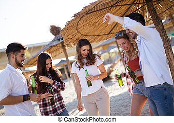 Happy group of young people having fun on beach