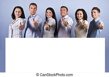 Happy group with blank banner and thumbs up - Happy group of...