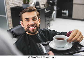Happy guy drinking beverage at beauty salon - Thank you for...