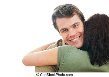 Happy guy hugging girlfriend
