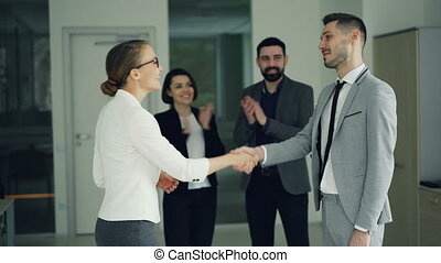 Happy guy in suit is getting job in company after successful...