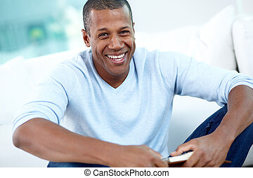 Happy guy - Image of young African man looking at camera...