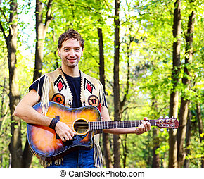 Happy guy playing guitar