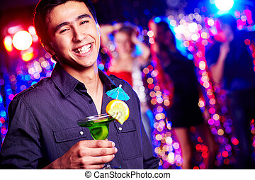 Happy guy with cocktail