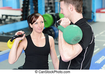 Happy gym workout with personal trainer