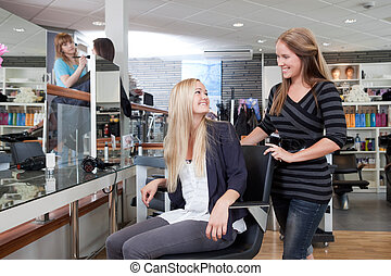 Happy Hairdresser with Customer