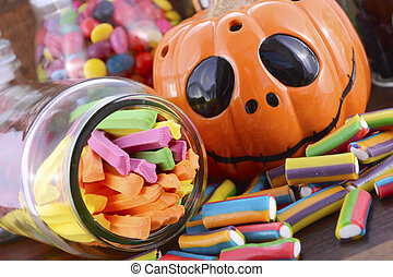 Happy Halloween Candy in Glass Apothecary Jars with orange...
