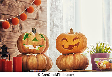 Carving pumpkin on the table