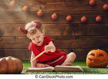 baby girl in devil costume