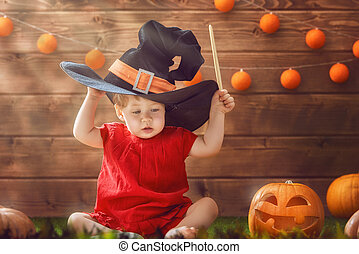 baby girl in witch costume