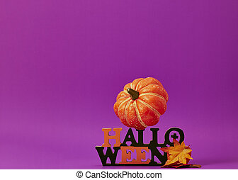 Happy halloween decorations on purple background