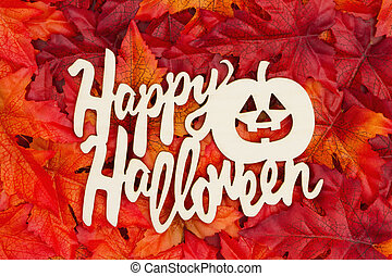 Happy Halloween greeting with fall leaves