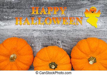 Happy Halloween greeting with orange pumpkins