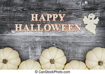 Happy Halloween greeting with white pumpkins