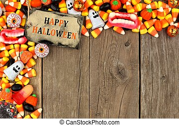 Happy Halloween tag with candy top corner border against...