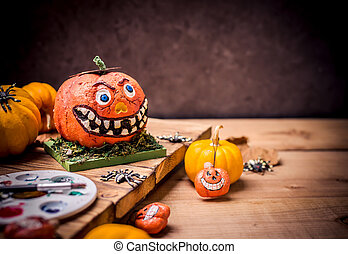 Happy Halloween. Werewolf or zombie hands painting scary pumpkin for trick or treat party. copy space for text