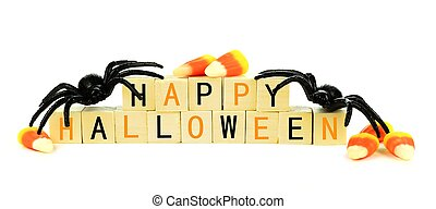 Happy Halloween wooden blocks with toy spider and candy corn...