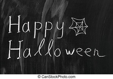 Happy Halloween writed with white chalk on a blackboard.