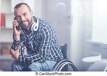 Happy handicap enjoying conversation on the phone at home
