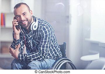 Happy handicap enjoying conversation on the phone at home