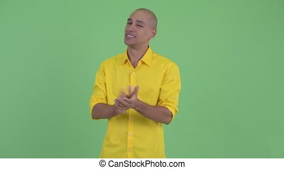 Happy handsome bald businessman clapping hands - Studio shot...