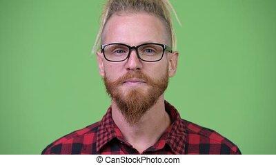 Happy handsome bearded hipster man with dreadlocks - Studio...
