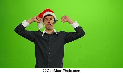 Happy handsome brutal man in Christmas hat. green screen. Slow motion
