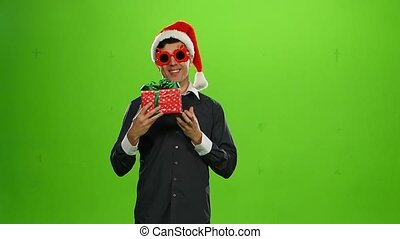 Happy handsome brutal man with a gift. green screen. Slow motion