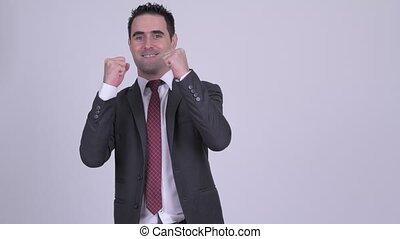 Happy handsome businessman getting good news - Studio shot...