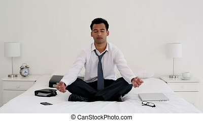 Happy handsome businessman meditati