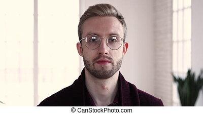 Happy handsome employee in eyeglasses looking at camera. - ...