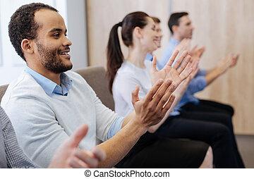 Happy handsome man applauding
