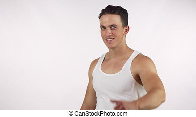 Happy handsome muscular man showing thumbs up, smiling to...