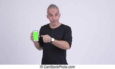 Happy handsome Persian man showing phone and giving thumbs up