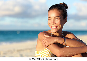 Happy healthy Asian chinese woman smiling on beach
