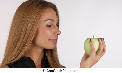Happy healthy beautiful woman smiling cheerfully, holding an apple